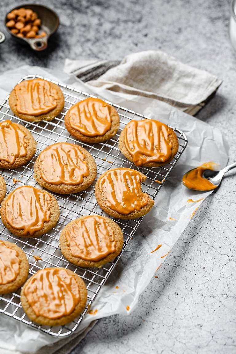 Freshly glazed Butterscotch cookies with a bite taken out of one