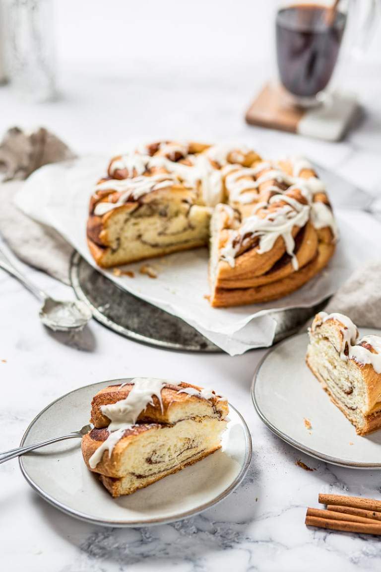 Cinnamon brioche braided loaf with slice on a plate